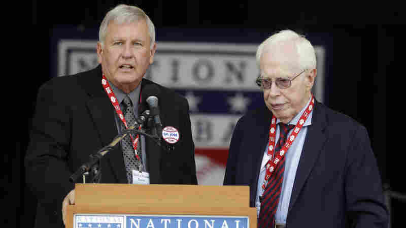 Retired baseball pitcher Tommy John, left, and Dr. Frank Jobe at the National Baseball Hall of Fame in July 2013. Jobe was honored for the pioneering surgery he first performed on John's elbow in 1974.