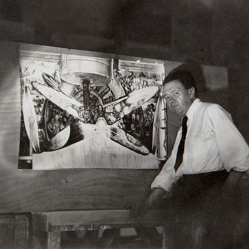 Artist Diego Rivera stands with a copy of the mural he painted at Rockefeller Center that was eventually destroyed.