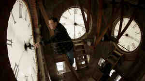 Custodian Ray Keen inspects a clock face before changing the time on a 100-year-old clock atop the Clay County Courthouse in Kansas Saturday. Americans will set their clocks forward one hour before heading to bed tonight; Daylight Saving Time officially starts Sunday at 2 a.m.