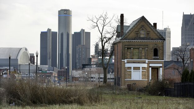 An abandoned home sits in an empty field in Brush Park, north of Detroit's downtown. The city is trying to recover from the largest municipal
