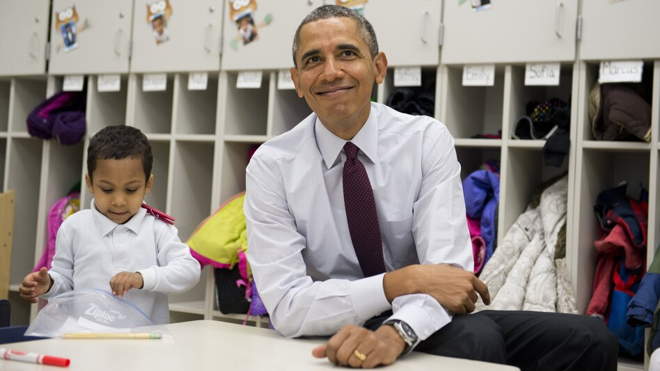 President Barack Obama sits with students during a tour of a Pre-K classroom at Powell Elementary School in Washington, D.C., this week. (Saul Loeb/AFP/Getty Images)