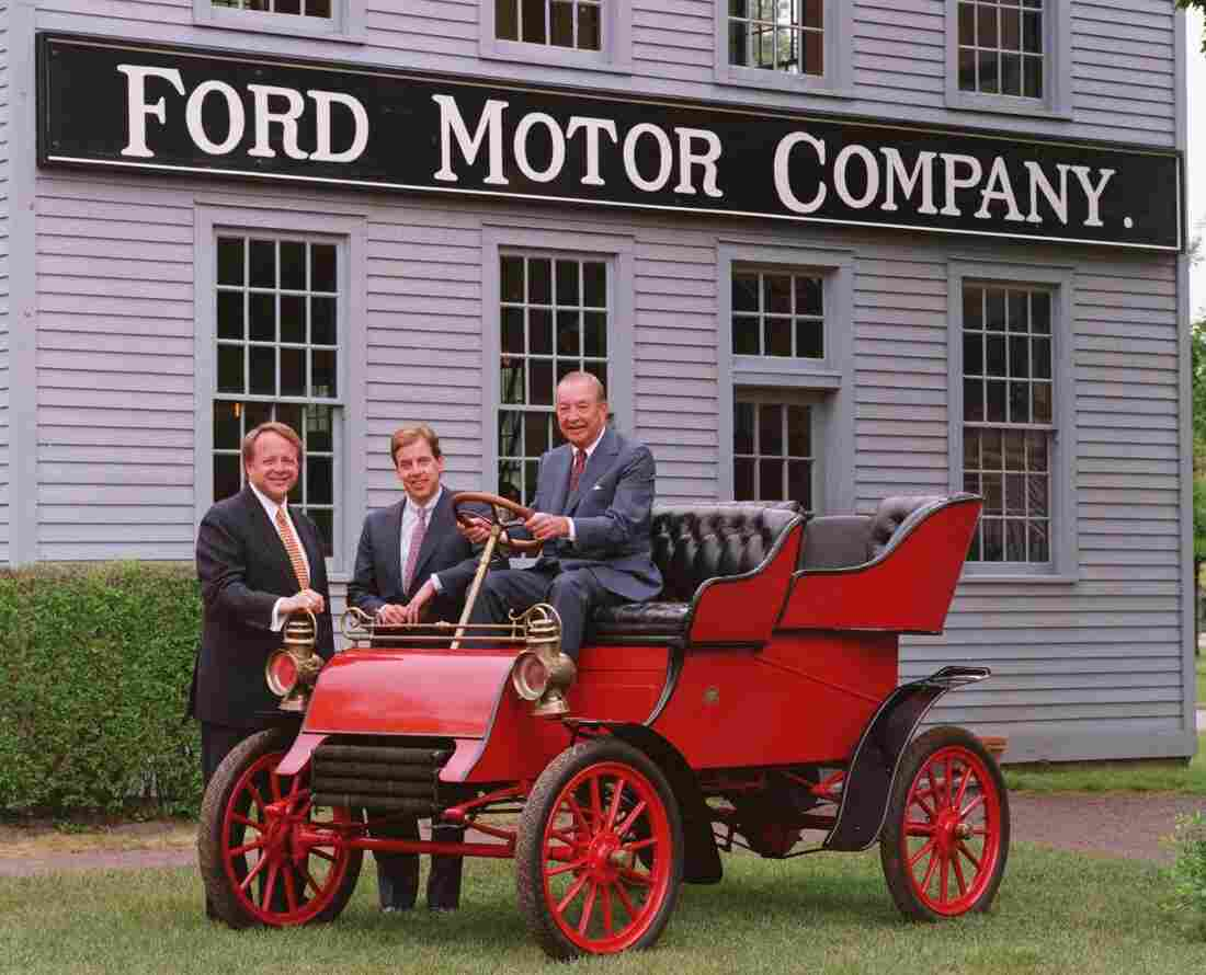 William Clay Ford, seen here in 1995 on a 1903 Ford Model A, has died at age 88. He posed for a photo with Edsel Ford II (left) and his son, William Clay Ford Jr.