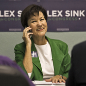 Florida Democratic congressional candidate Alex Sink works the phone in Clearwater, Fla., on Nov. 23.