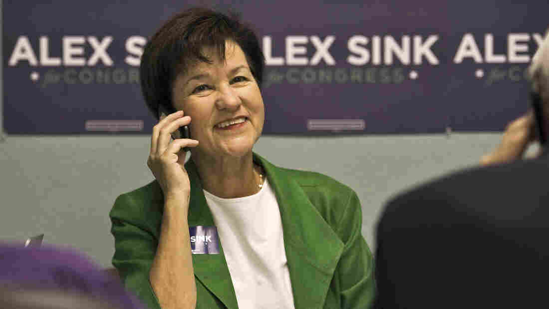 Florida Democratic congressional candidate Alex Sink, shown working the phone in Clearwater on Nov. 23, supports the Affordable Care Act but has said she would like to see it improved.