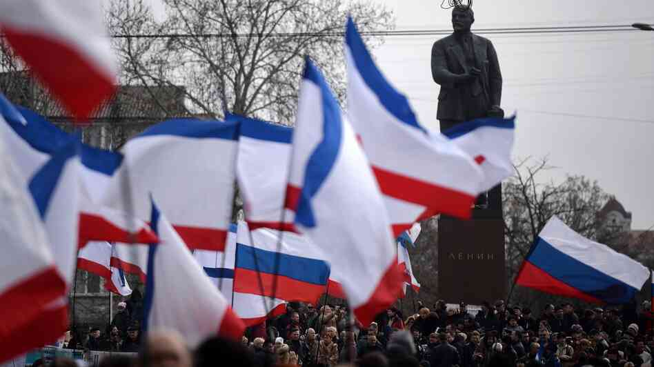 Russian and Crimean flags were being waved during a pro-Russia rally Sunday in Simferopol's Lenin Square. Simferopol is the capital of Crimea, an autonomous region of Ukraine.