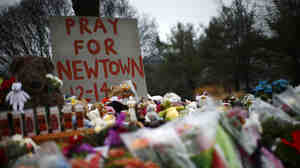 Flowers, candles and stuffed animals at a makeshift memorial in Newtown, Conn., the week after 20 children and 6 adults were killed at Sandy Hook Elementary School.