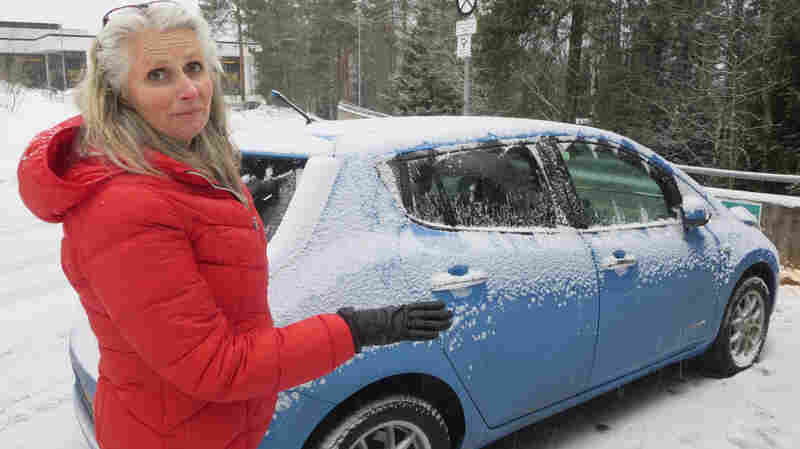 Jonette Øyen with her Nissan Leaf outside the National Archives in Norway, where she works. Next month Norway is expected to become the first country where one in every 100 cars is purely electric.