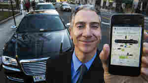 Seattle's government has given early approval to caps on ride-share companies such as Uber. Here, Peter Faris, whose company's drivers use Uber to find customers, holds a smartphone with the ride-sharing company's app in Washington, D.C.