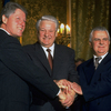 President Bill Clinton (from left), Russian President Boris Yeltsin and Ukrainian President Leonid Kravchuk, clasp hands after signing documents whereby the U.S. and Russia agreed to stop aiming long range nuclear missiles at each other, and the Ukraine agreed to dismantle all of its 1,800 nuclear warheads. The event took place on Jan. 14, 1994, at the Kremlin in Moscow.