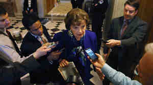 Sen. Dianne Feinstein speaks to reporters after speaking about her oversight committee's problematic relationship with the CIA Tuesday. CIA Director John Brennan says his agency isn't trying to delay the panel's report on the U.S. interrogation program.