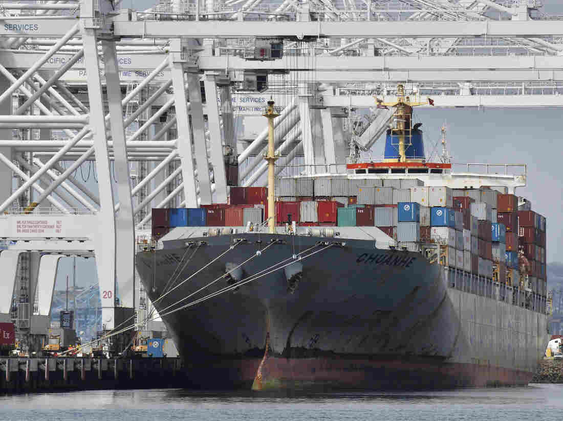 A cargo ship stands on Long Beach harbour, California.