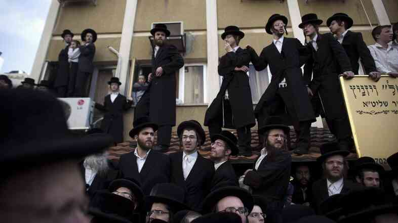 Ultra Orthodox Jewish men attend the funeral of Rabbi Moshe Yehoshua Hagar in Bnei Brak, outside Tel Aviv, in 2012.
