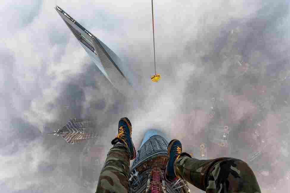 Raskalov on top of Shanghai Tower, one of the tallest buildings in the world at 2,073 feet.