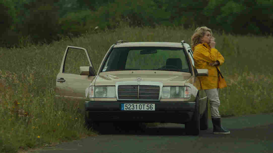In a twist of sorts on the typical male- or youth-driven road movie, Catherine Deneuve plays an older woman playing young.