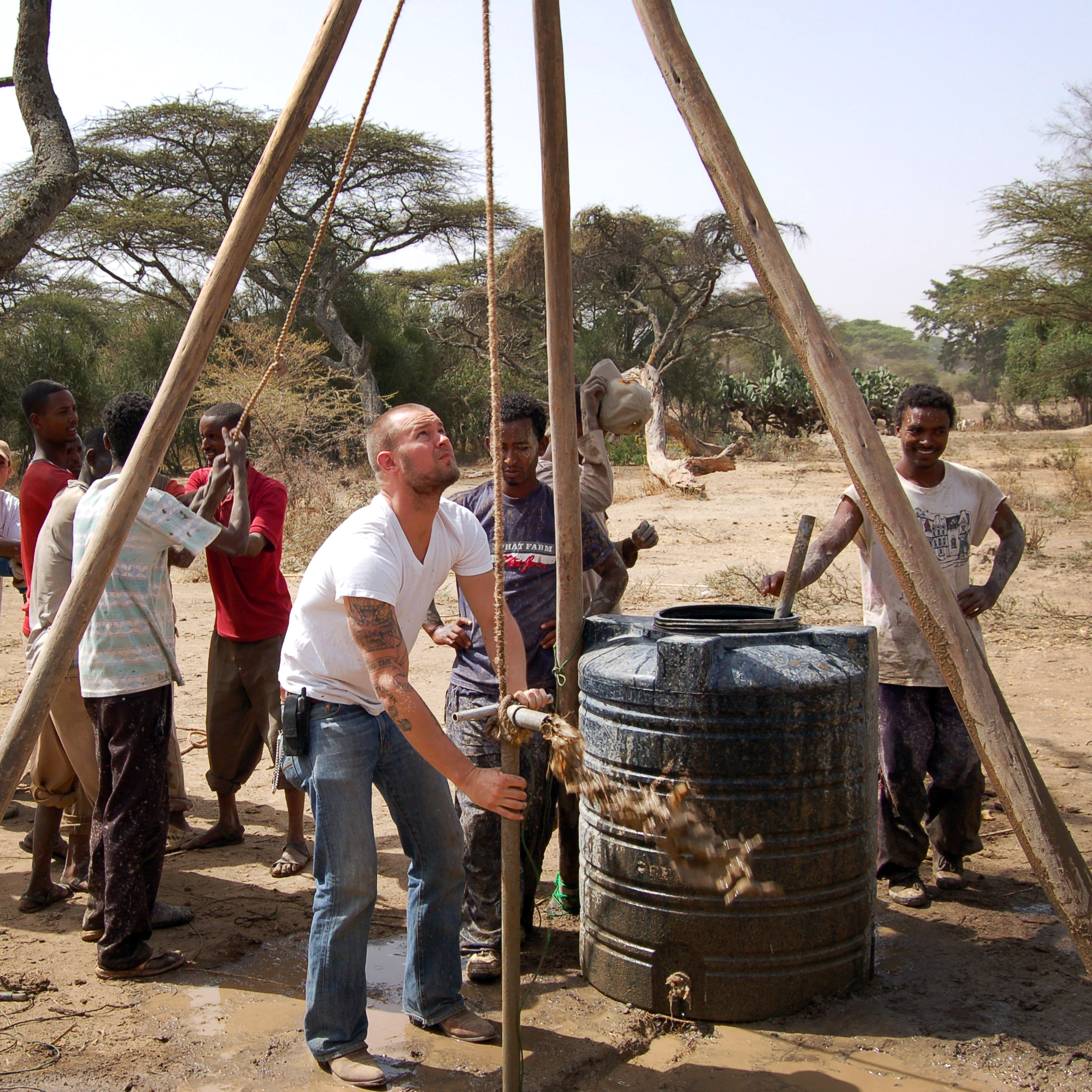 The Water to Wine Machine hoax was designed to bring attention to Wine to Water, an international water charity. The group's president, Doc Hendley, is pictured above, center, in Ethiopia.