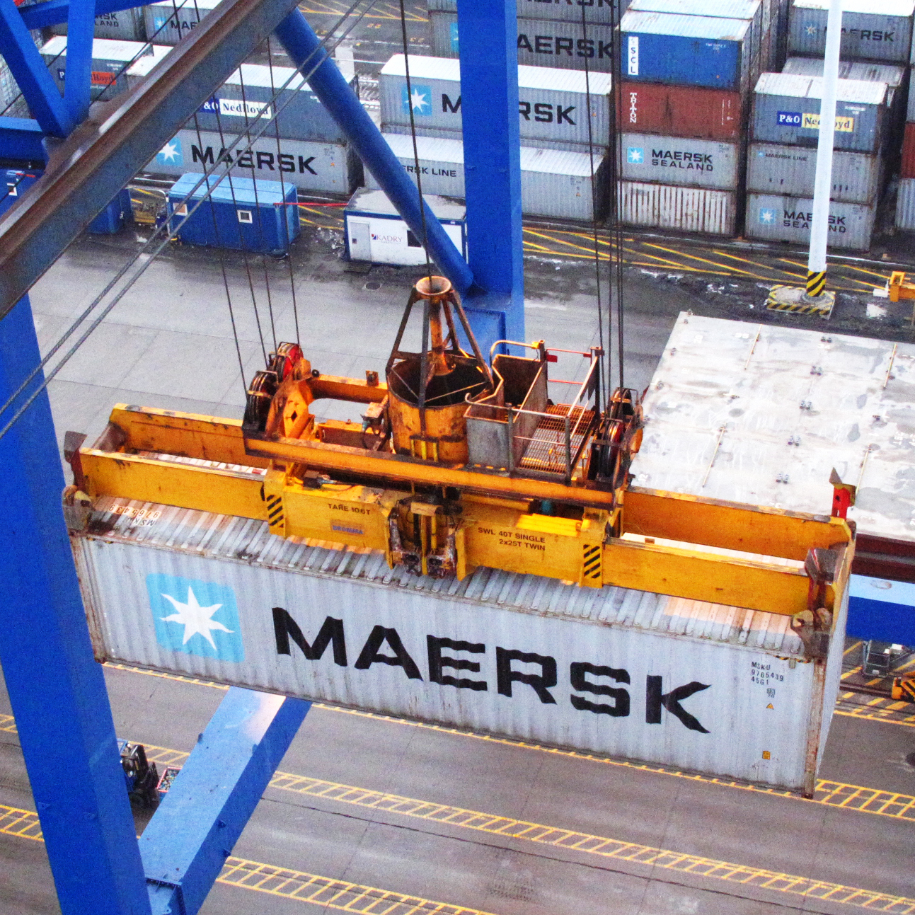 Huge cranes load containers, some weighing up to 25 tons, onto the Maersk McKinney Moller while it's in port in Gdansk, Poland.