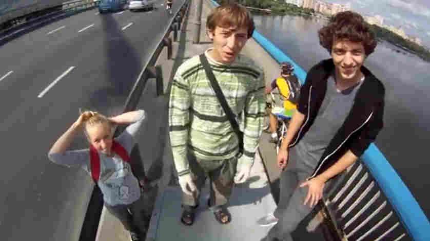 Raskalov and his friends before he leads them up to the top of the Moscow Bridge in Kiev, Ukraine.