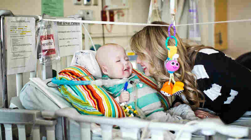 """Garrett shares a moment with his mother, Natalie Peterson. """"He has been doing so good,"""" she says. """"He's been smiling."""""""
