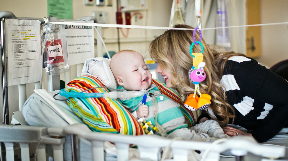 "Garrett shares a moment with his mother, Natalie Peterson. ""He has been doing so good,"" she says. ""He's been smiling."" (Nicole Haley/University of Michigan Health System)"