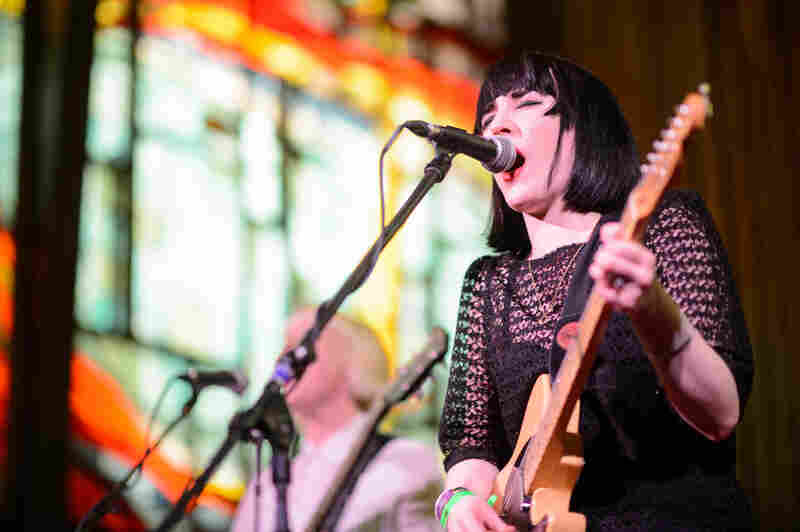 "NPR's Robin Hilton called Pins' set at Central Presbyterian Church ""sort of brash, surfer garage punk rock. Hardly anyone there. They needed a mosh pit."""