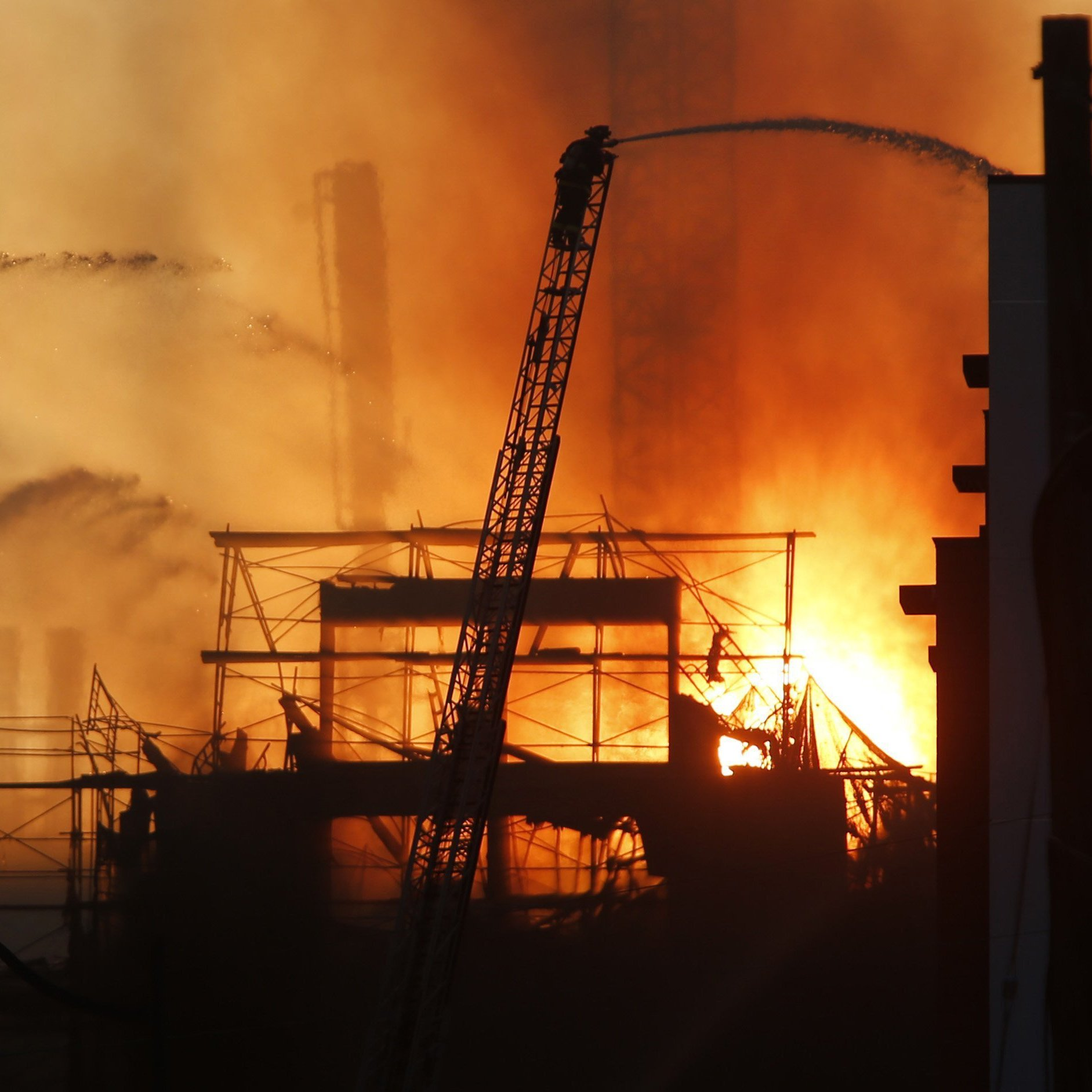 Firefighters battle the multi-story blaze in a residential building under construction Tuesday in San Francisco's Mission Bay neighborhood.