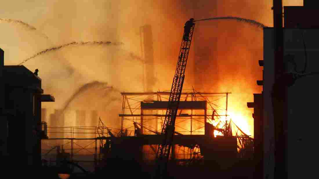 Firefighters battle the multistory blaze in a residential building under construction Tuesday in San Francisco's Mission Bay neighborhood.