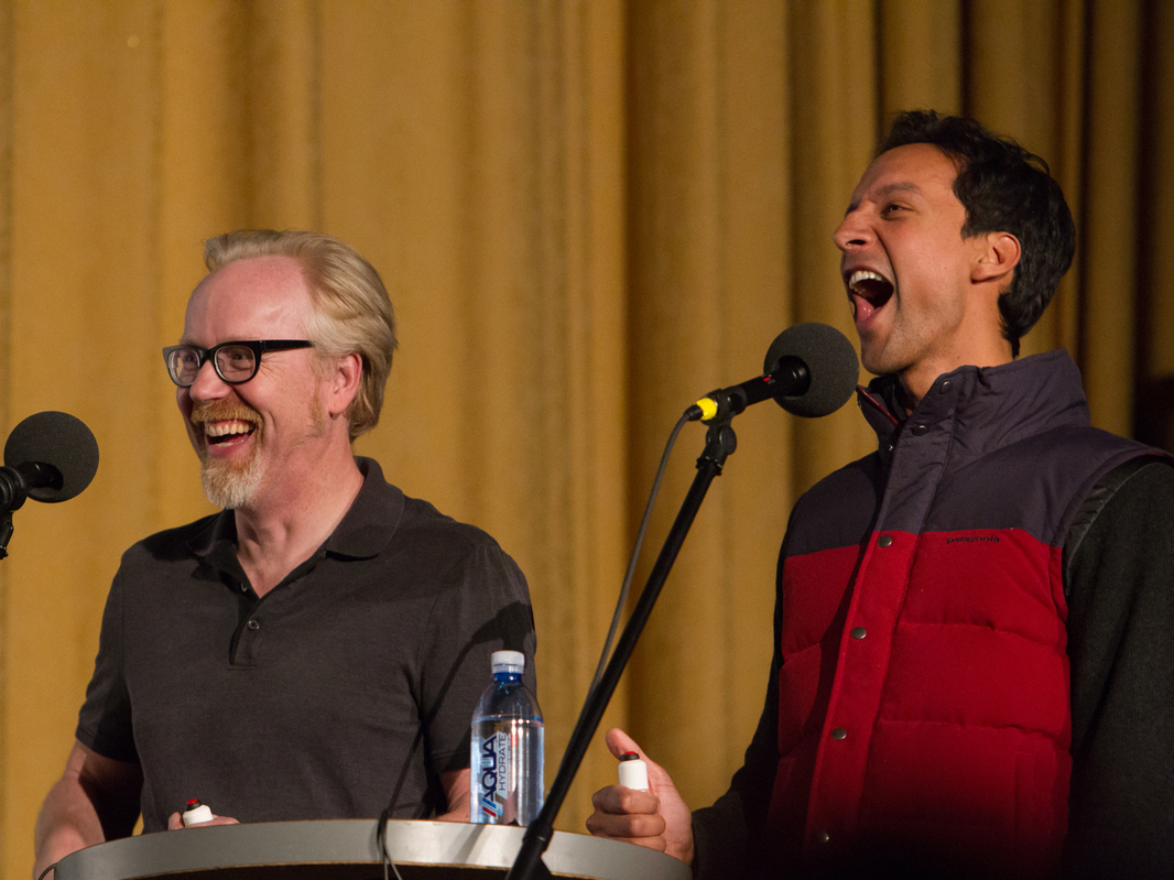 Cobra...or Kindergarten Cop? Danny Pudi (left) takes on Mythbusters' Adam Savage in an Ask Me Another Challenge.