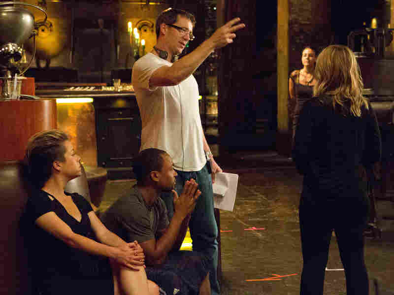 Rob Thomas directs Kristen Bell (right), Percy Daggs (center) and Tina Majorino on the set of the Veronica Mars movie.