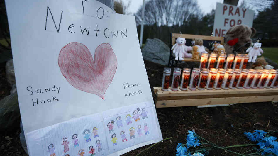 A child's message stands out at a memorial for Sandy Hook Elementary School shooting victims in Newton, Conn.