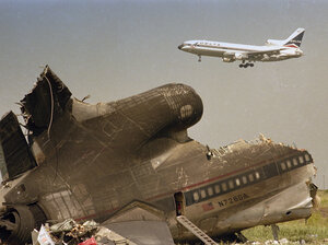 """The charred tail section of Delta Flight 191 sits near a runway at Dallas-Fort Worth International Airport in August 1985 after it crashed on approach. Delta quickly retired the """"191"""" designation."""
