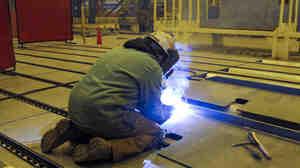A welder at Aker Philadelphia Shipyard.
