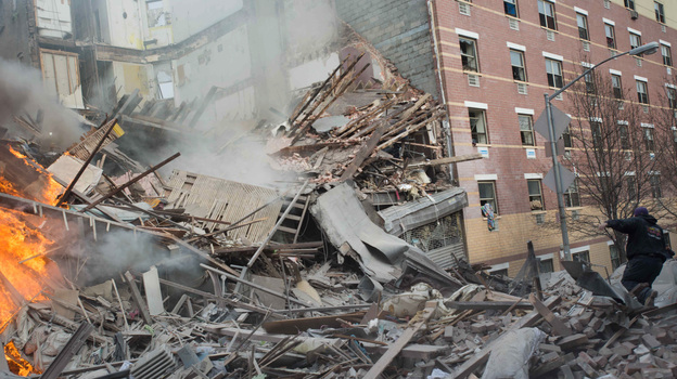 Two buildings collapsed in Harlem on Wednesday after an explosion and fire. Authorities say there were reports of a gas leak shortly before the blast. (AP)