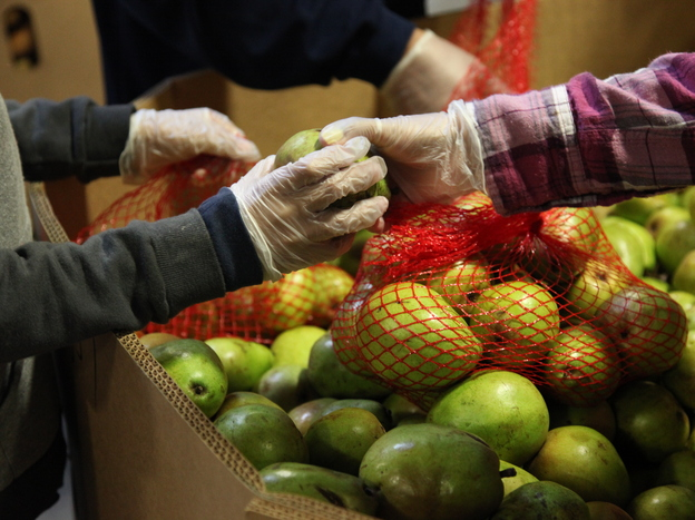States are taking an out provided by Congress to avoid cutting food stamp benefits to families, many of whom already depend on food banks like the Alameda County Community Food Bank in Oakland, Calif.