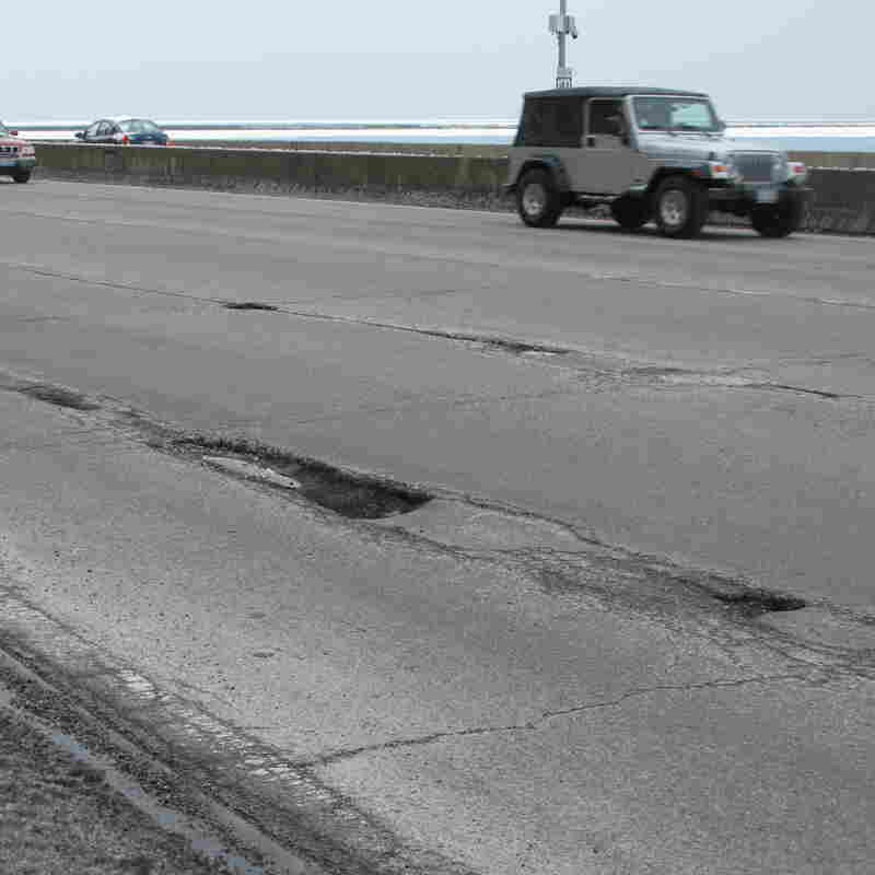 Potholes on Chicago's Lake Shore Drive, one of which is about half-a-car-length long and at least a foot deep. The city of Chicago says it has filled an estimated 240,000 potholes this winter, 100,000 more than last winter, at a cost of more than $2.8 million.