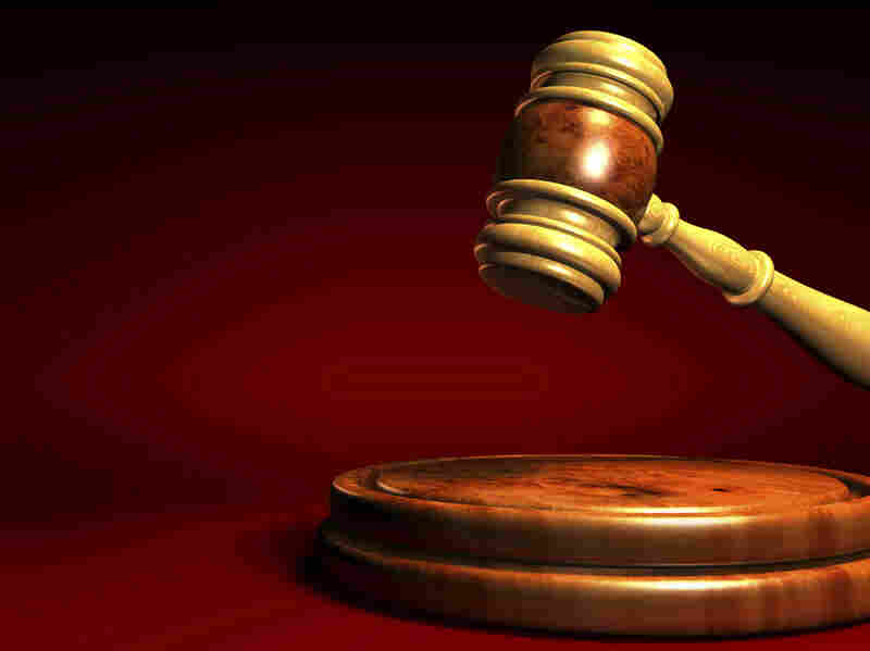 A gavel strikes — perhaps to figuratively call the end of a book auction.