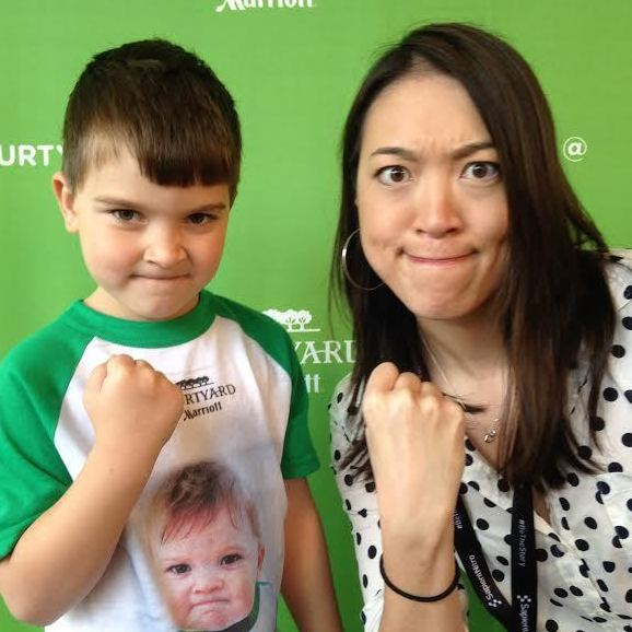 "Internet meme ""Success Kid"" was once a baby (as seen on his shirt), but now he's all grown up. Elise Hu mirrors the pose."