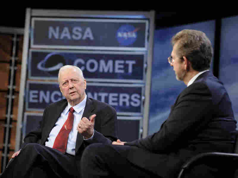 During a 2010 symposium commemorating a quarter-century of comet discoveries, Farquhar (left) swapped stories with James L. Green, NASA's director of planetary science.