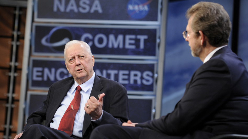 During a 2010 symposium commemorating a quarter-century of comet discoveries, Farquhar (left) swapped stories with James L. Green, NASA's director of planetary science. (NASA)