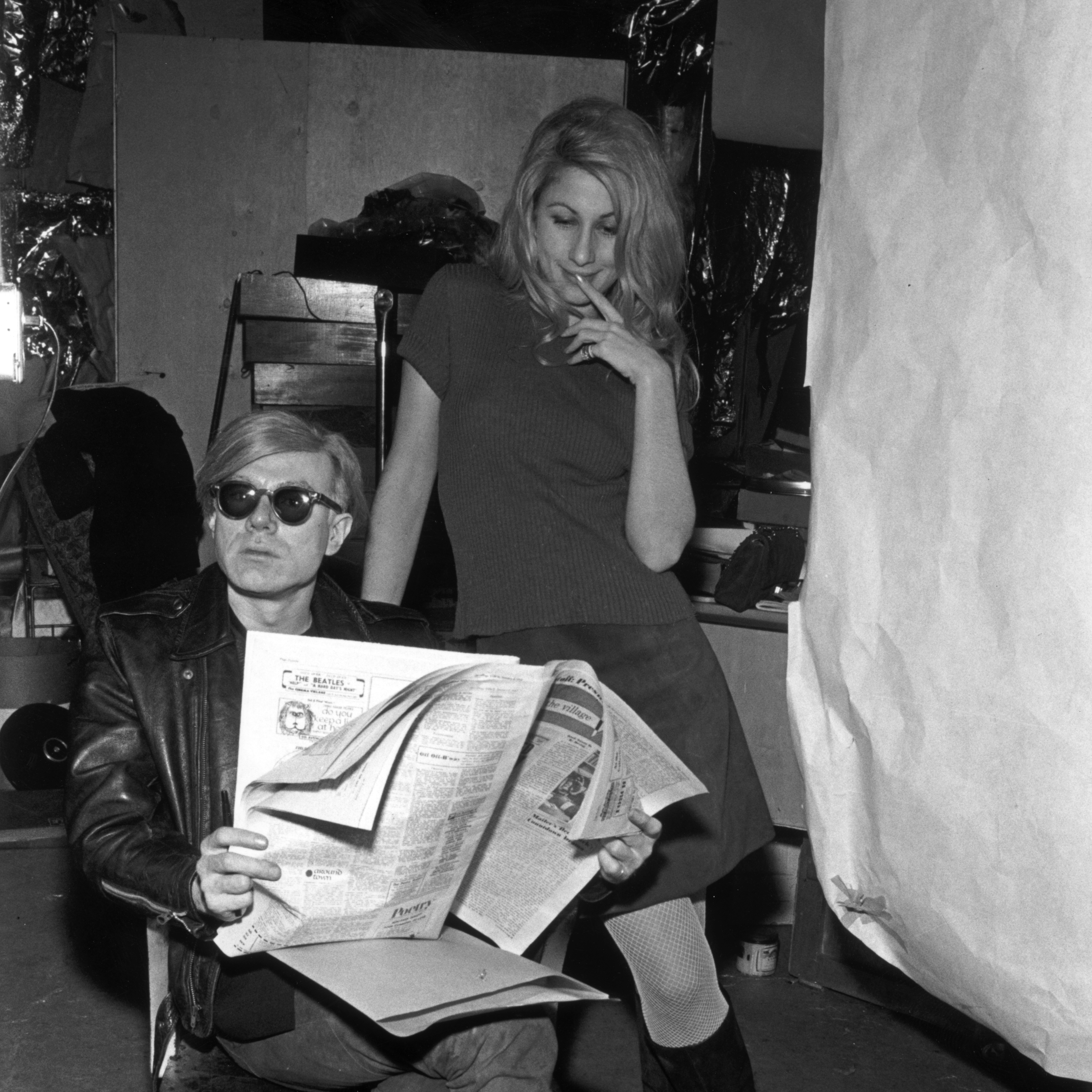 Artist Andy Warhol and Baby Jane Holzer during the filming of Warhol's film Chelsea Girls in 1967.