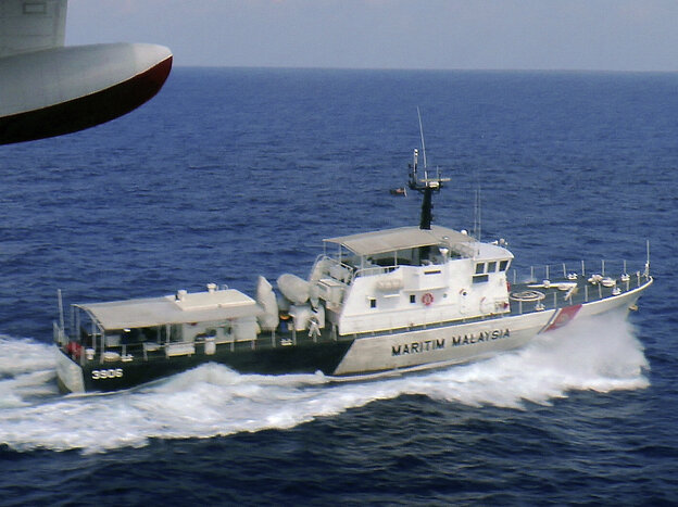 In this photo released by Malaysian Maritime Enforcement Agency, a patrol vessel of Malaysian Maritime Enforcement Agency searches for the missing Malaysia Airlines plane off Tok Bali Beach in Kelantan, Malaysia, on Sunday.