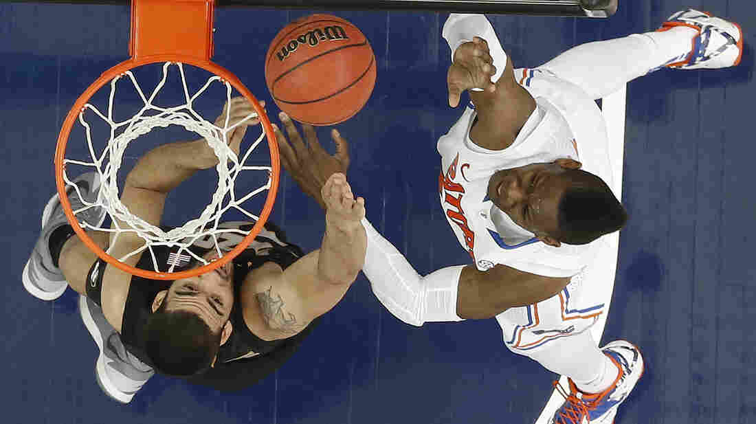Florida's Will Yeguete shoots over Missouri's Keanau Post in the quarterfinal round of the Southeastern Conference men's tournament on Friday in Atlanta. Investor Warren Buffett is betting $1 billion that no one can pick all 63 winners of the NCAA college basketball tournament that begins next week.
