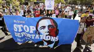 Demonstrators protest the Obama administration's deportation policies, in Phoenix last year.