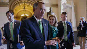 House Speaker John Boehner of Ohio leaves the House chamber on Capitol Hill in Washington, after House Republicans passed a measure Friday that would overhaul the system Medicare uses to p