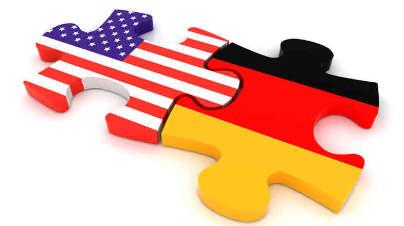America and German flags as puzzle pieces.