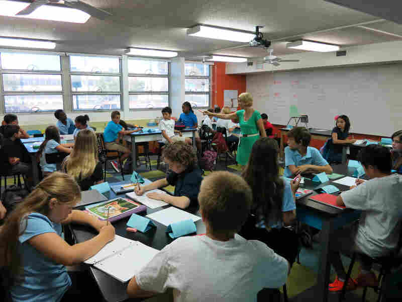 Teacher Cari Noble asks students to discuss quotes about risk-taking at Intellectual Virtues Academy.