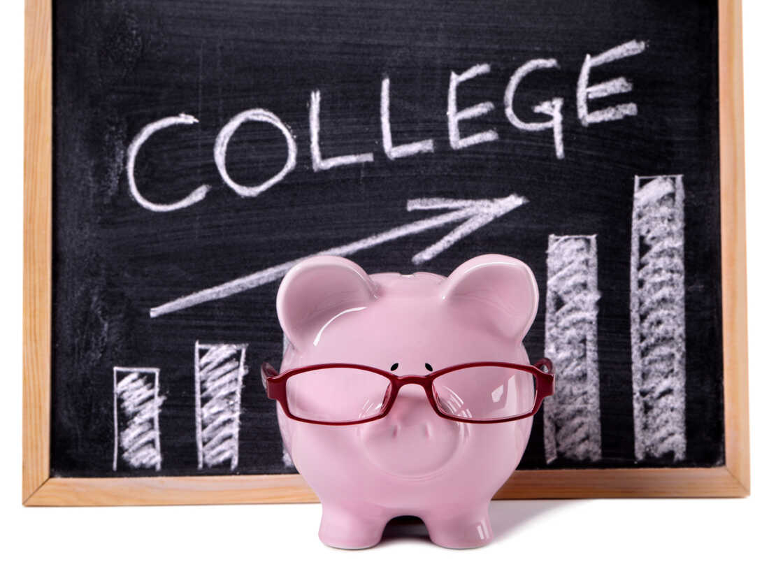 Pink piggy bank with glasses standing in front of a blackboard with simple college savings chart.