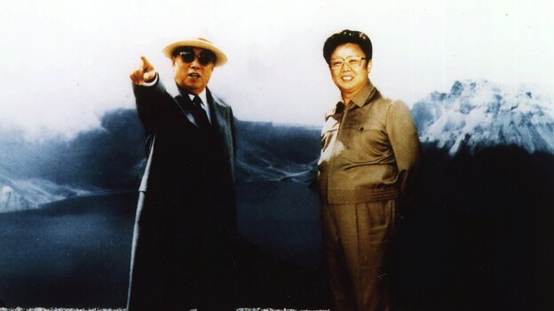 Kim Jong Il (right) and his father, Kim Il Sung, are pictured on what is believed to be Paekdoo San, a mountain located along the Sino-North Korean border in this image released by the North Korean news agency in 1994.