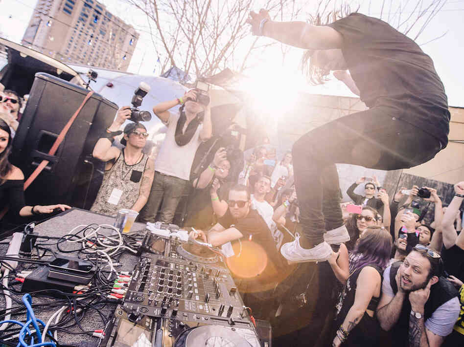 Skrillex skipped the main room at Empire and went straight to the DJ booth, with fans watching from building tops.