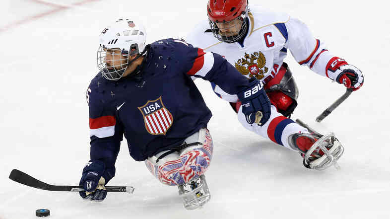 The U.S. hopes to repeat as Paralympic gold medalists in sled hockey Saturday, when the team will play host Russia. Earlier this week, Nikko Landeros of USA was chased by Dmitrii Lisov of Russia during group play at the Sochi 2014 Paralympic Winter Games.