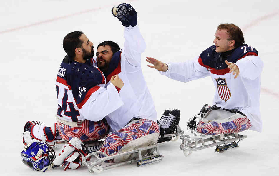 Steve Cash of the USA (from left) celebrates winning gold Saturday, with teammates Nikko Landeros and Joshua Pauls. The Americans beat Russia in the championship game, 1-0.